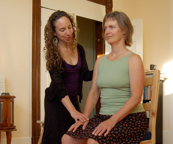 Woman sitting in a chair and receiving lesson on Alexander Technique by San Francsco teacher Elyse Shafarman.